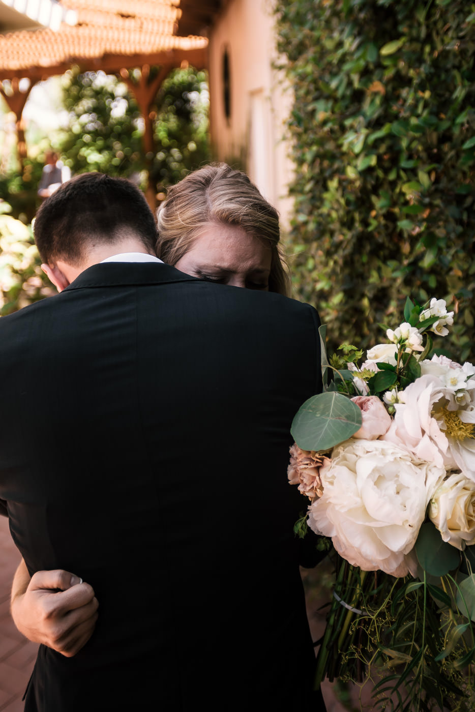 This lovely bride cried on her grooms shoulder as the emotions of seeing each ohter for the first time was too overwhelming