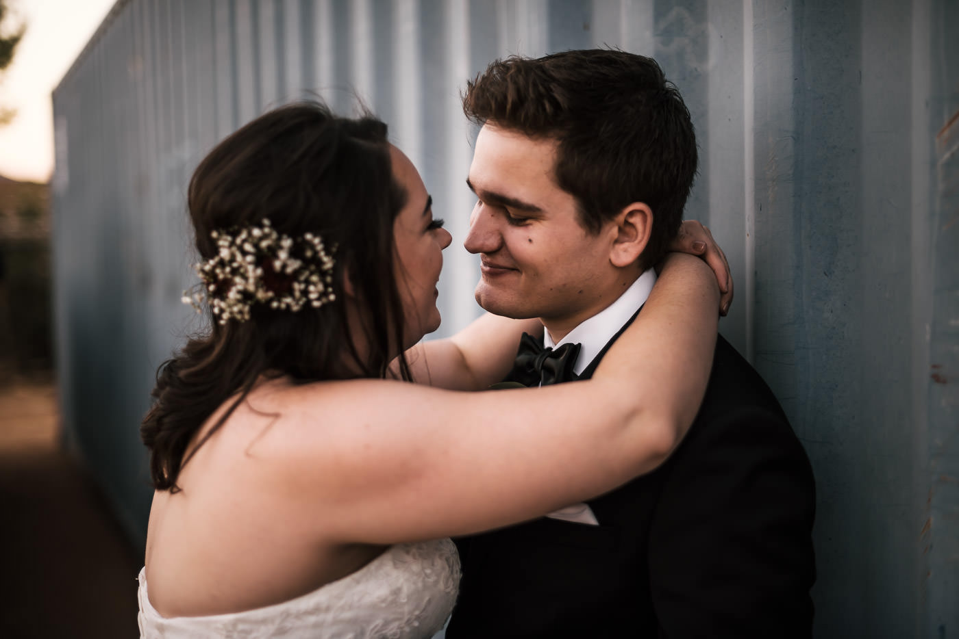 groom looks lovingly at his bride as they share a romantic moment at their country wedding in temecula