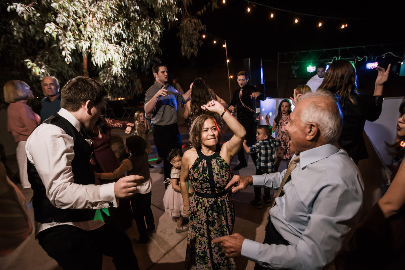Guests tear up the dance floor as the Dj plays at this Temecula wedding reception.