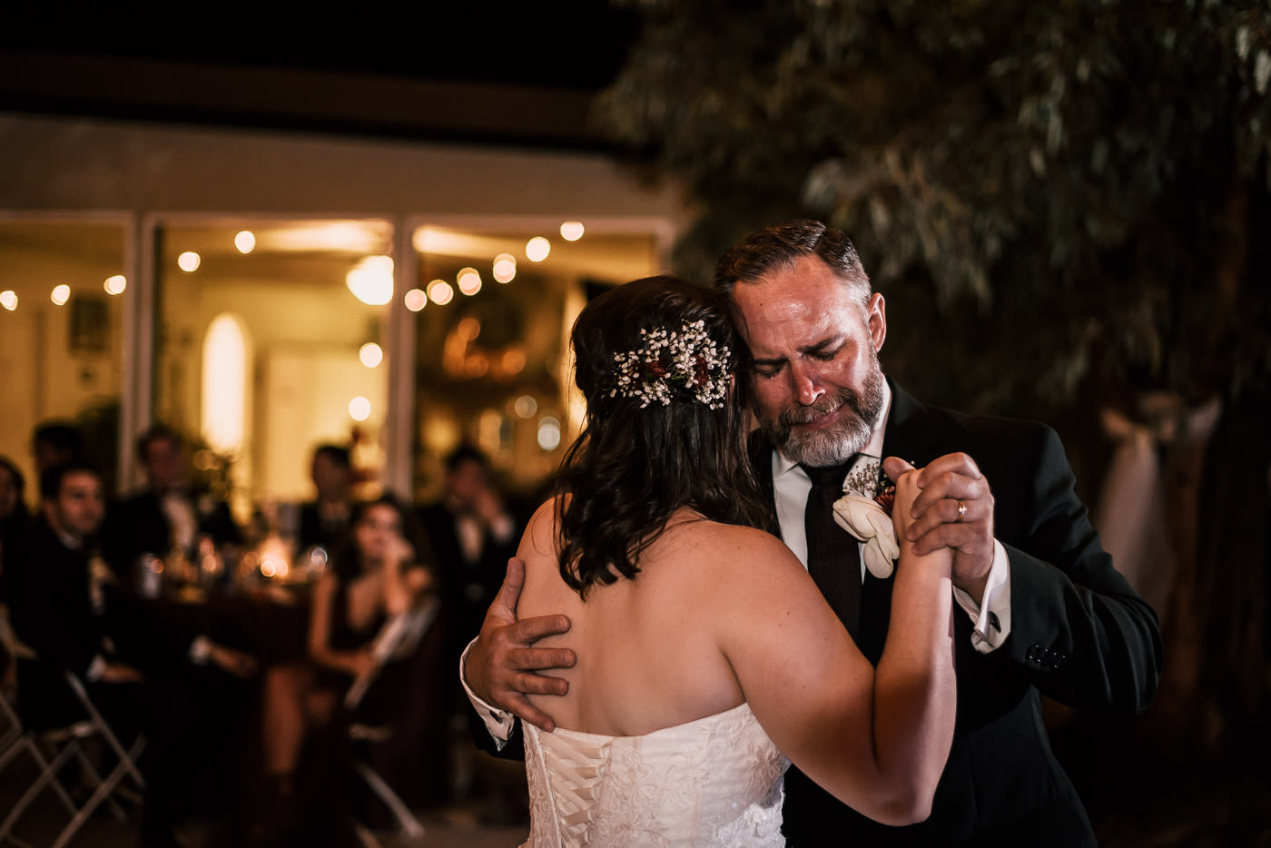 Touching photograph of a father dancing with his daughter at her Temecula wedding.
