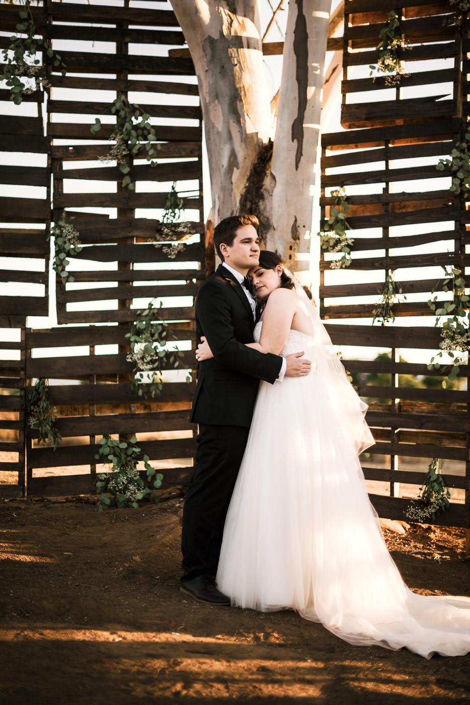 Couple enjoys a quiet moment alone after their wedding ceremony in the Temecula Wine Country.