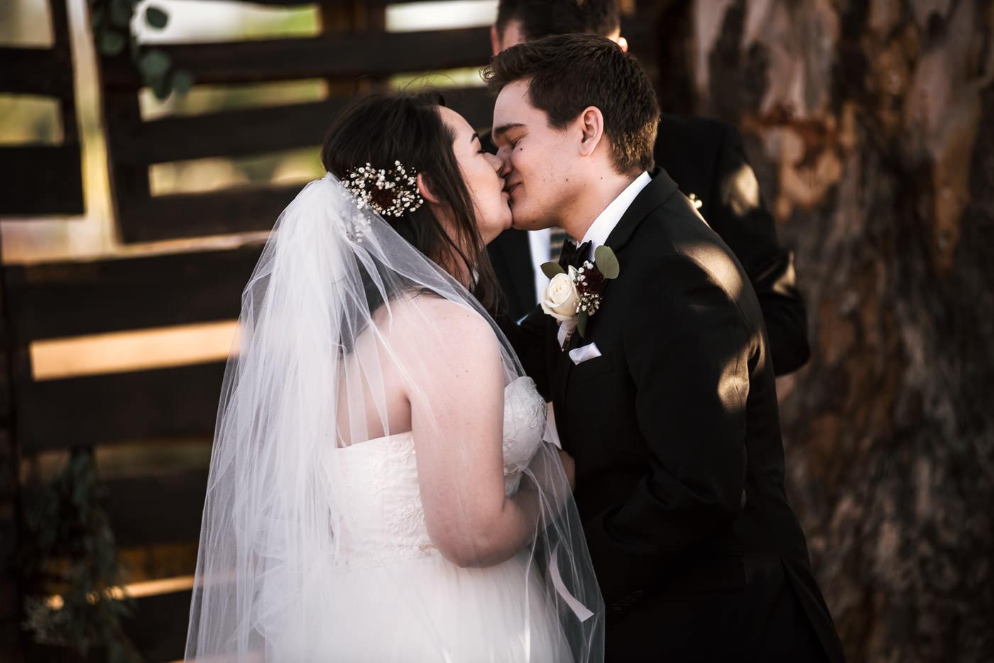 First kiss at romantic country wedding Temecula California.