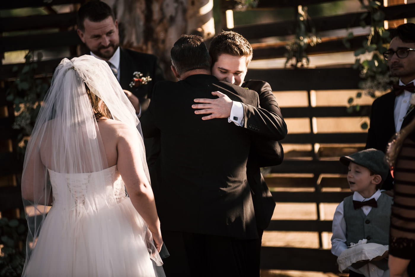 Groom hugs his father in law in touching photograph at their Temecula wedding.