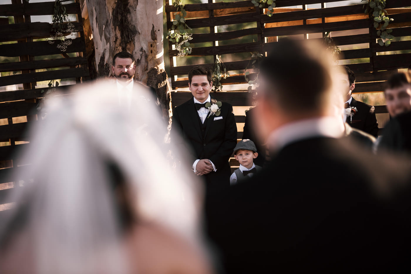 Emotional groom sees his bride for the first time as she walks down the aisle.