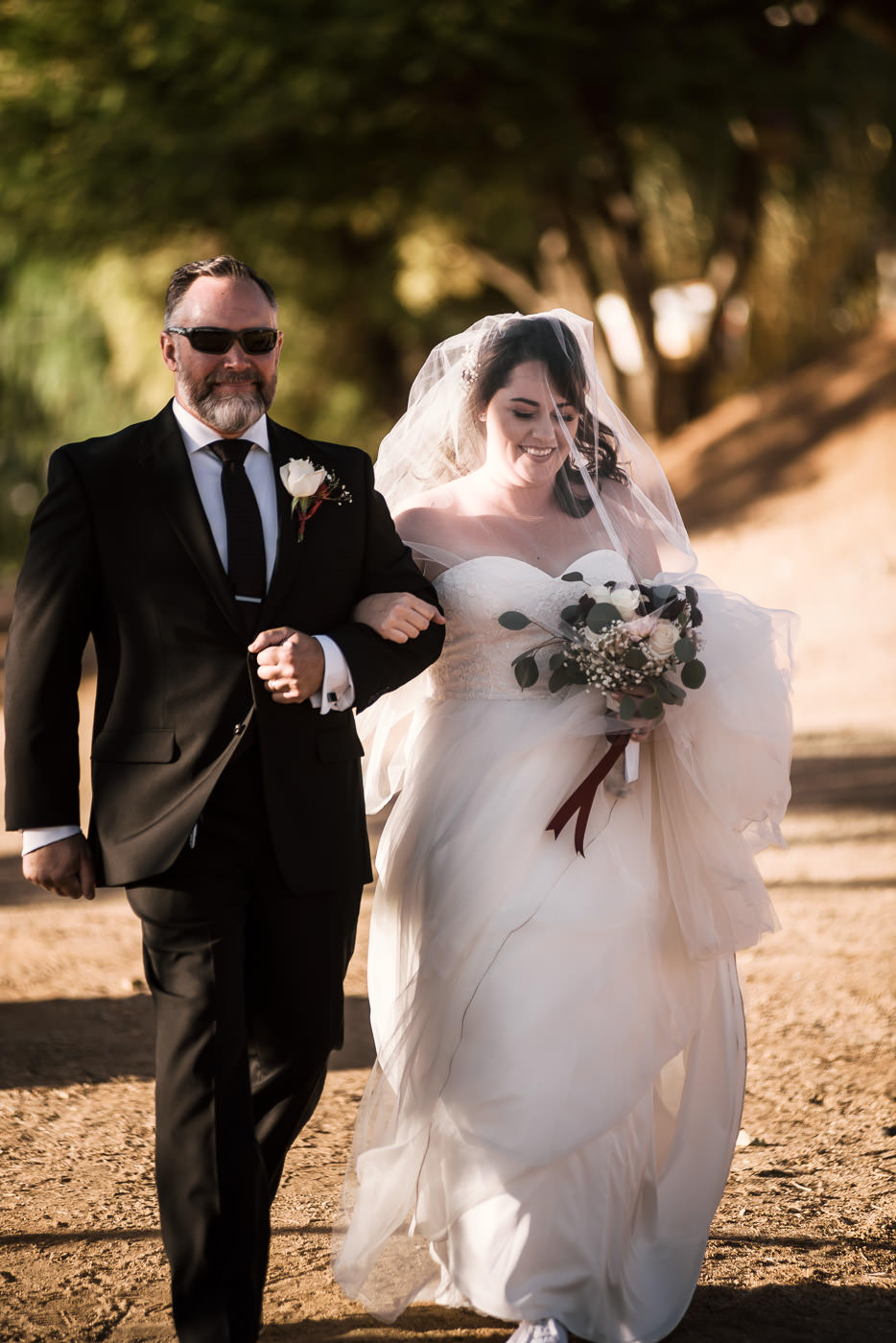 Father walks his daughter down the aisle at her country wedding in Temecula.