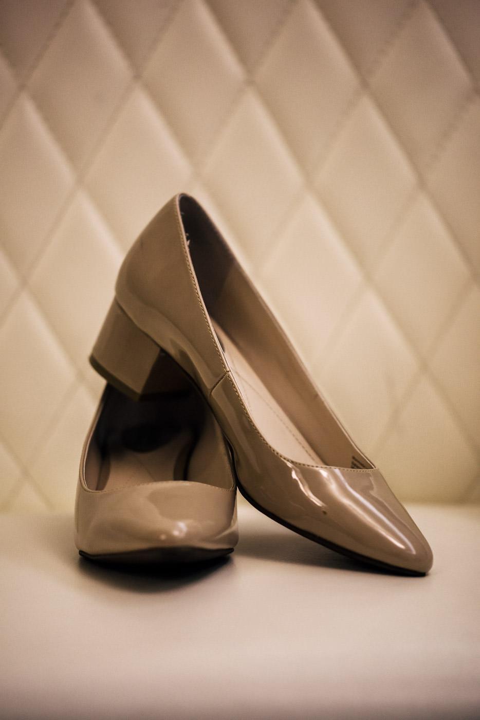 Brides beige heels for her wedding.