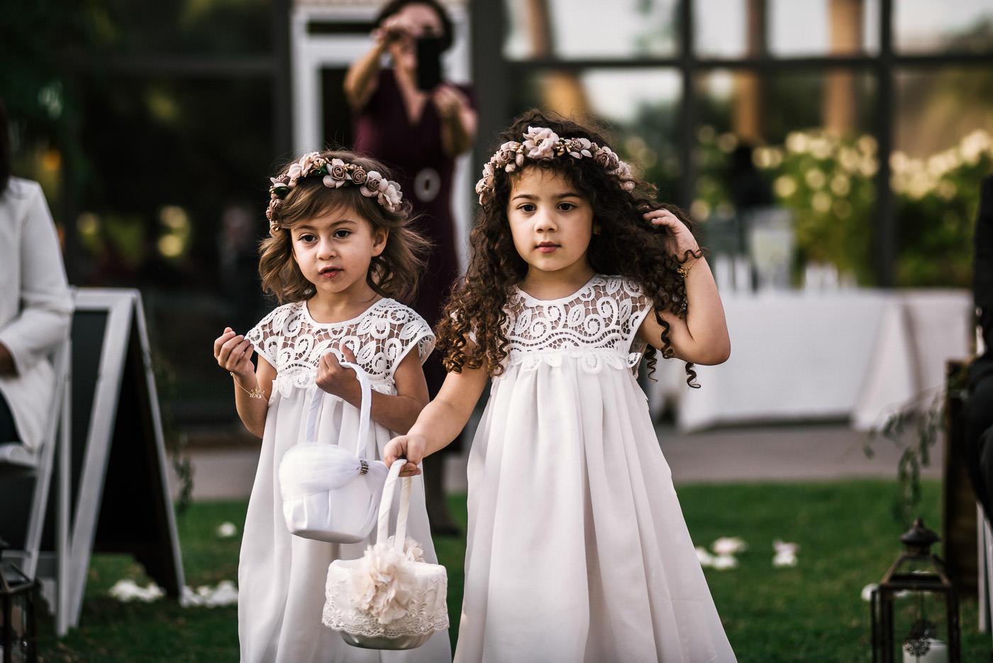 Two adorable flower girls walk down the aisle at Knollwood Country Club wedding.