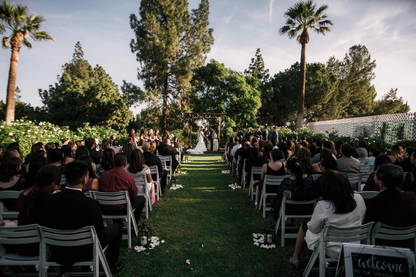 Knollwood country club wedding ceremony rose garden location.