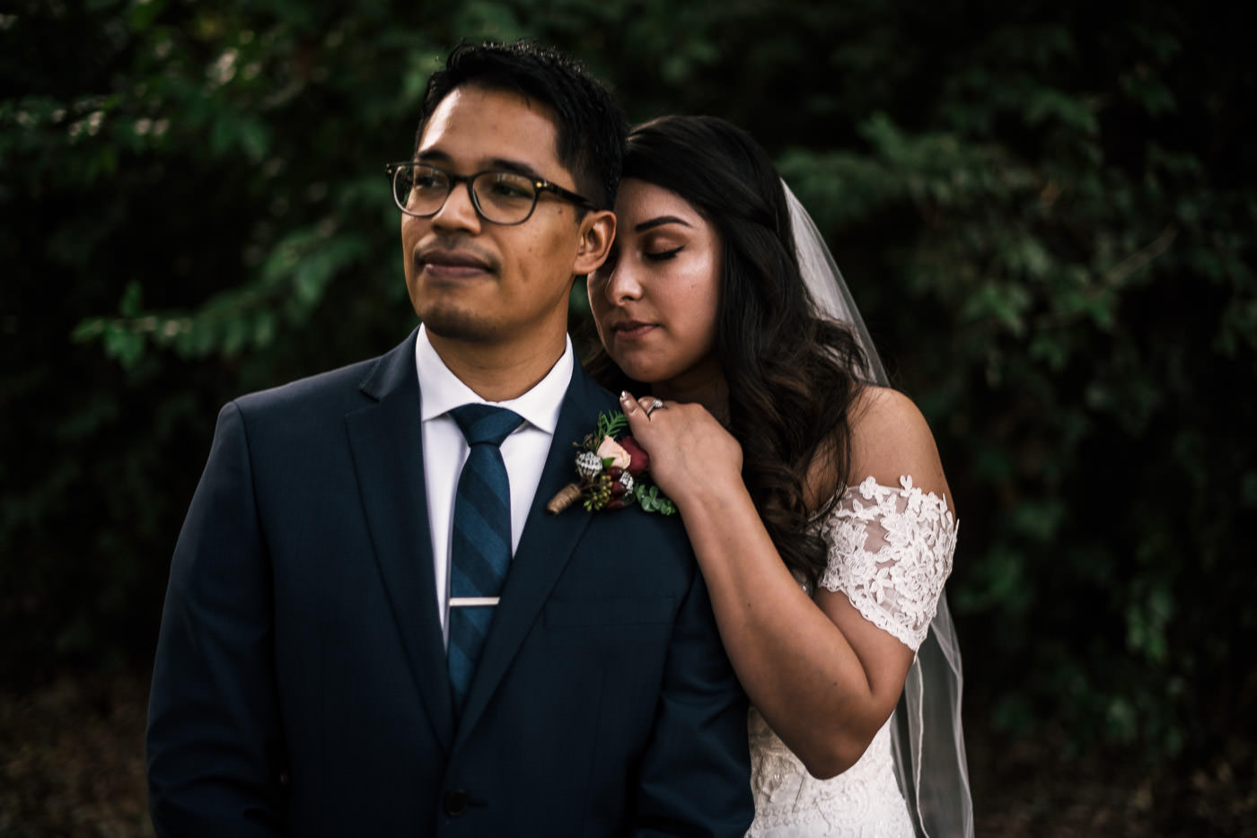 Couple takes beautiful portraits with their photographer at this Knollwood Country club wedding in Granada Hills.