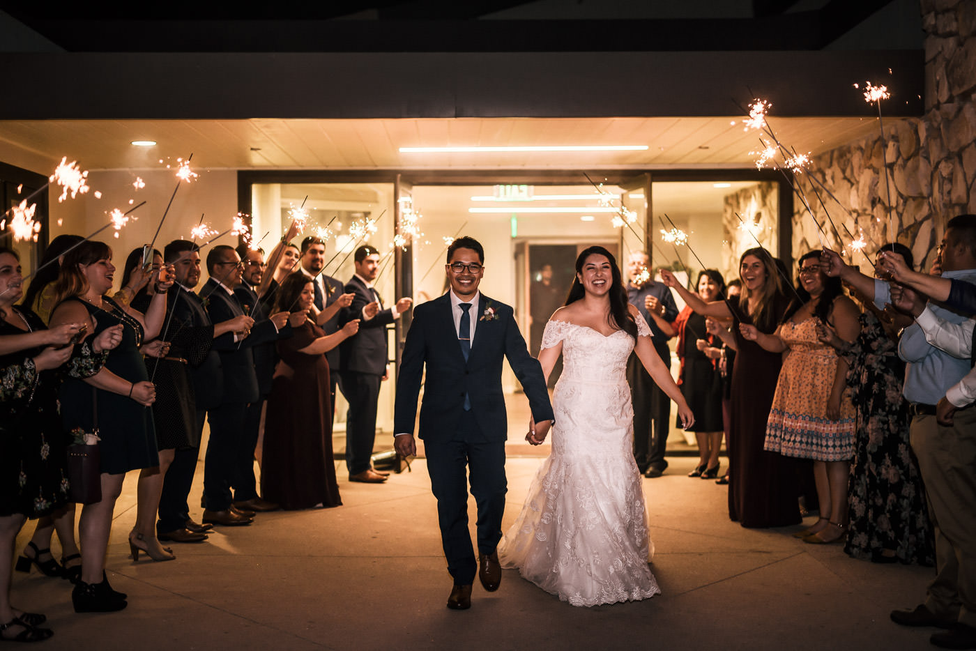 Grand exit with sparklers at this lovely couples Knollwood Country Club Wedding.