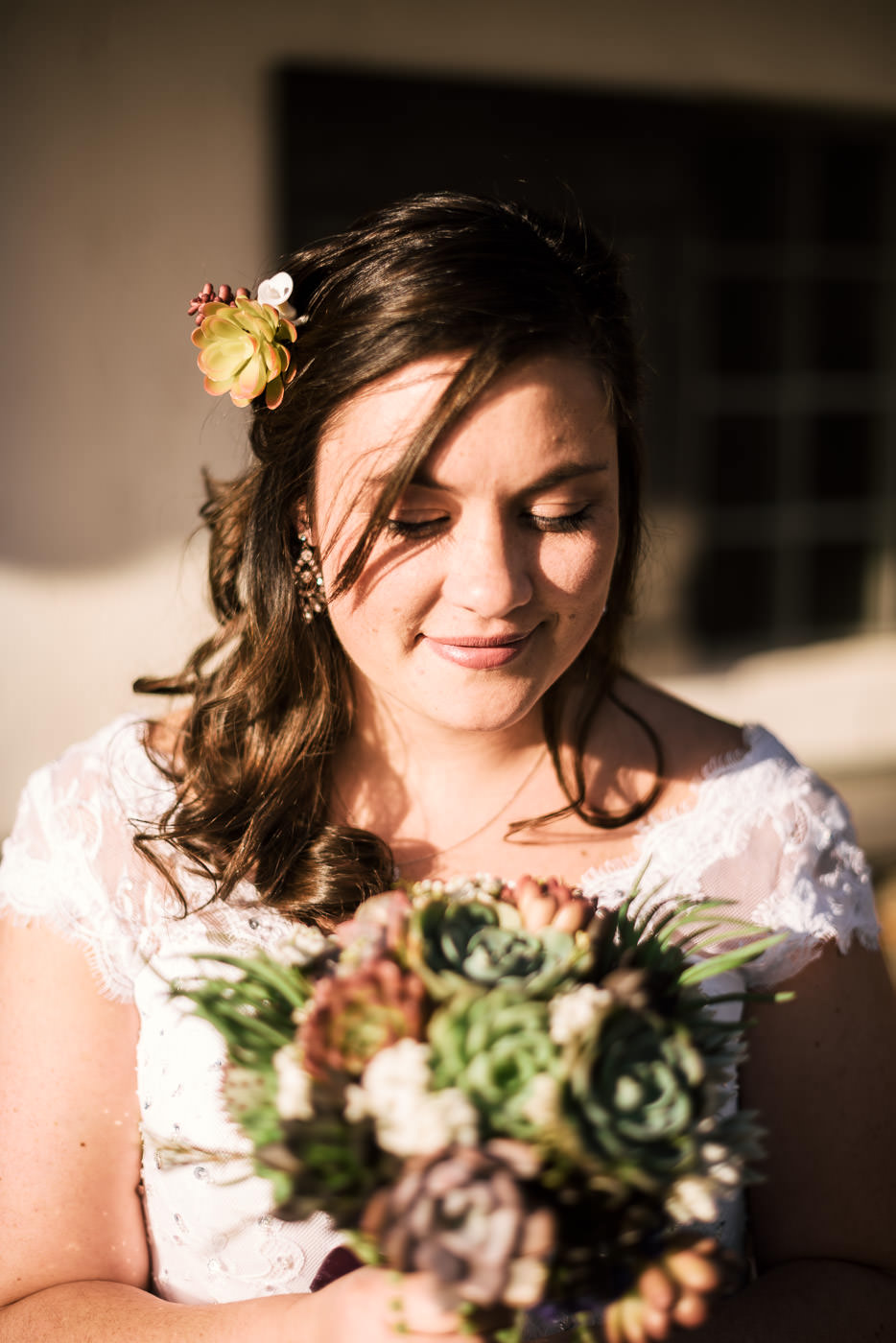 Bride poses with her wedding bouquet before heading to the ceremony.