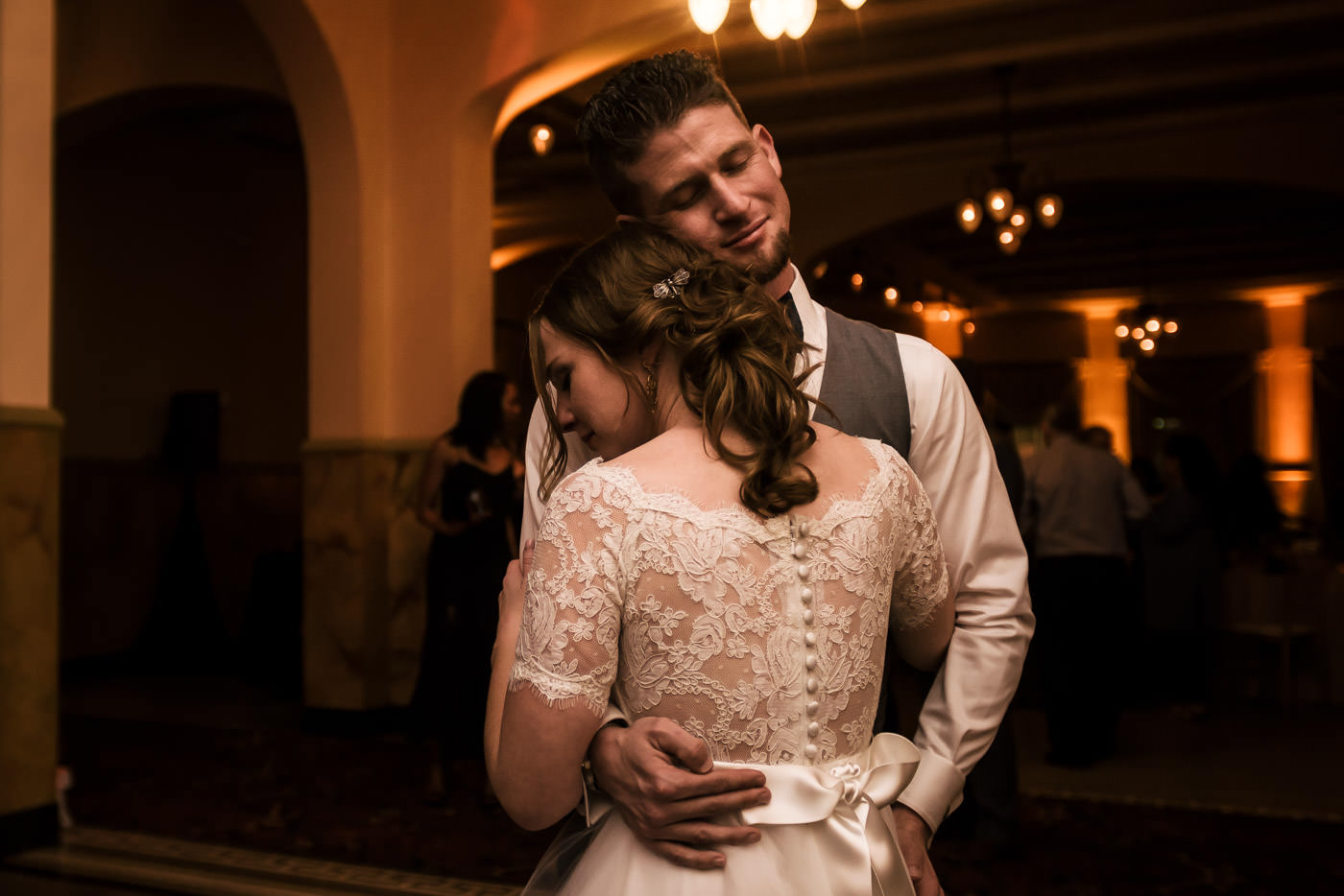 Bride and groom slow dance for the first time after their wedding at the Castle Green in Pasadena California