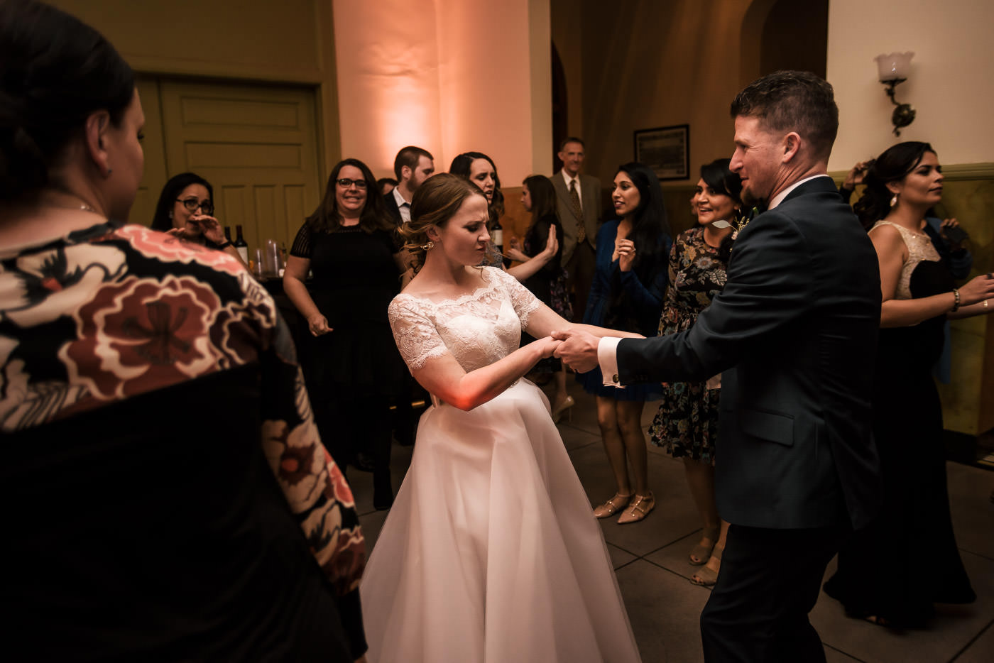 Bride and groom tear up the dance floor with their guests.