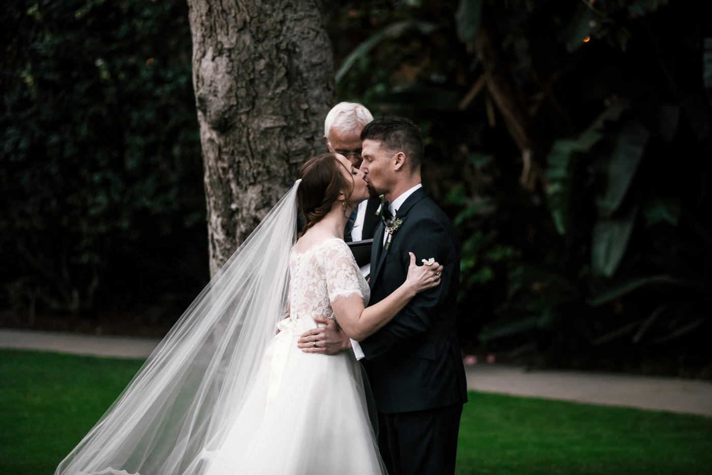 Beautiful first kiss at a romantic wedding in Pasadena.