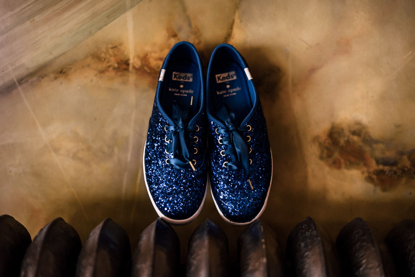 Bride choses Blue sparkle Kate Spade Keds for her wedding reception shoes.