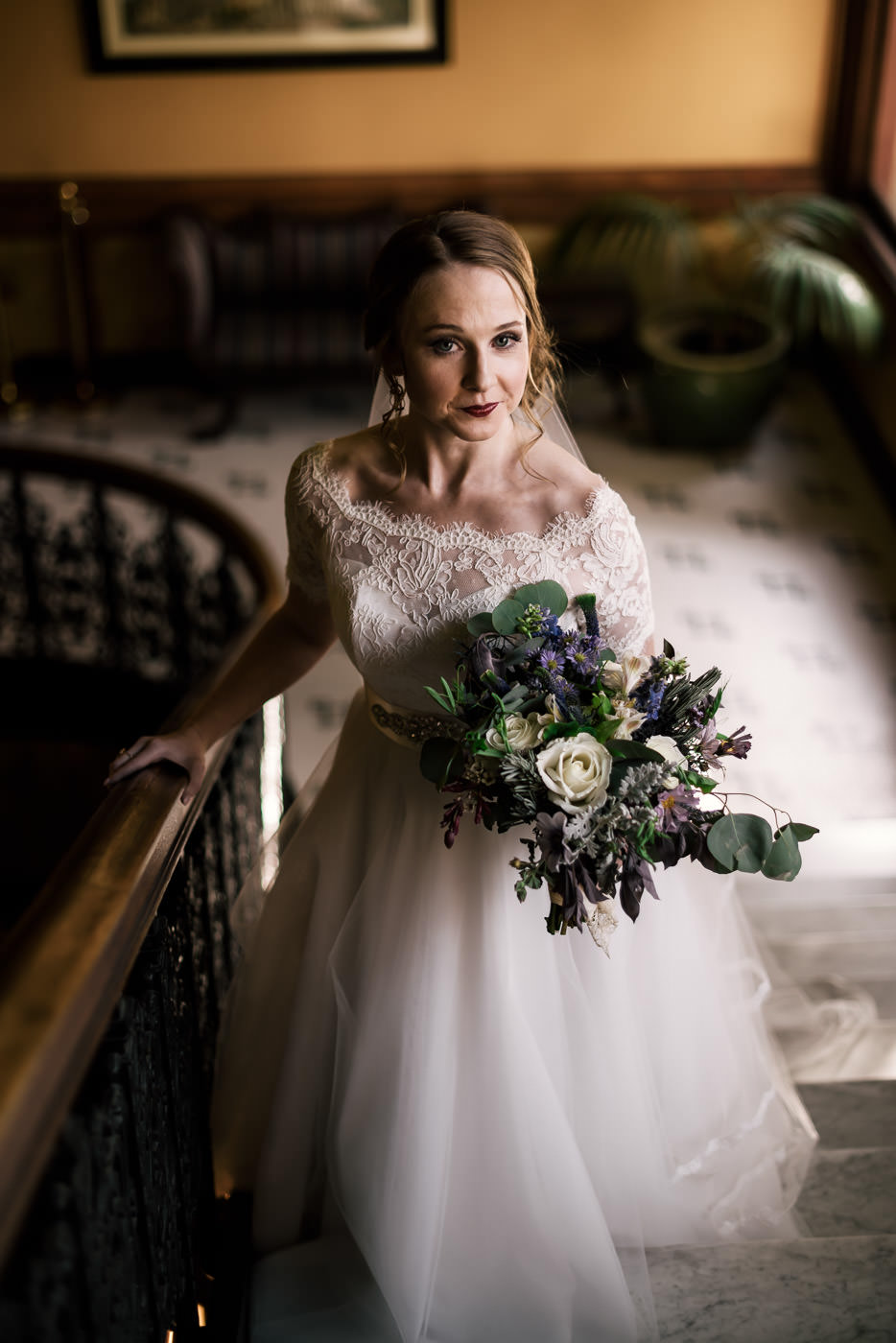 Beautiful vintage bride poses on the staircase of the Castle Green in Pasadena.