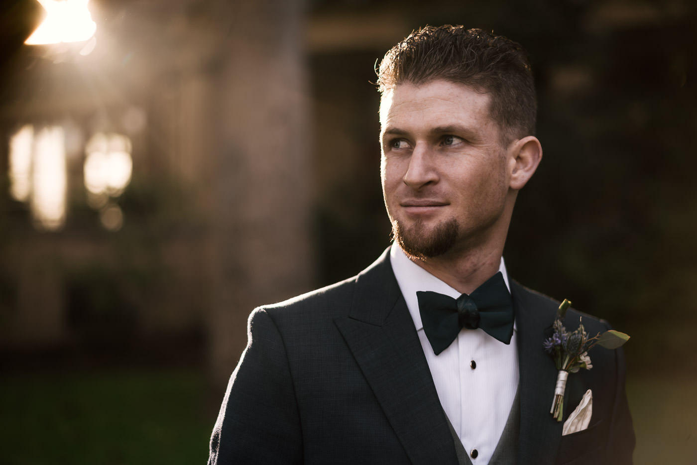 Sunset portrait of a groom before his wedding at the romantic Castle Green in Pasadena