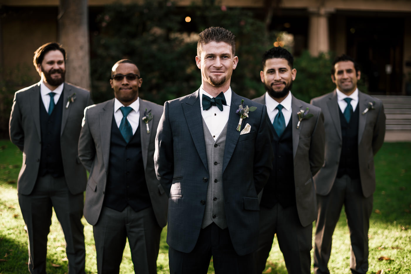 Grom stands with his groomsmen in the lawn of the Castle Green.