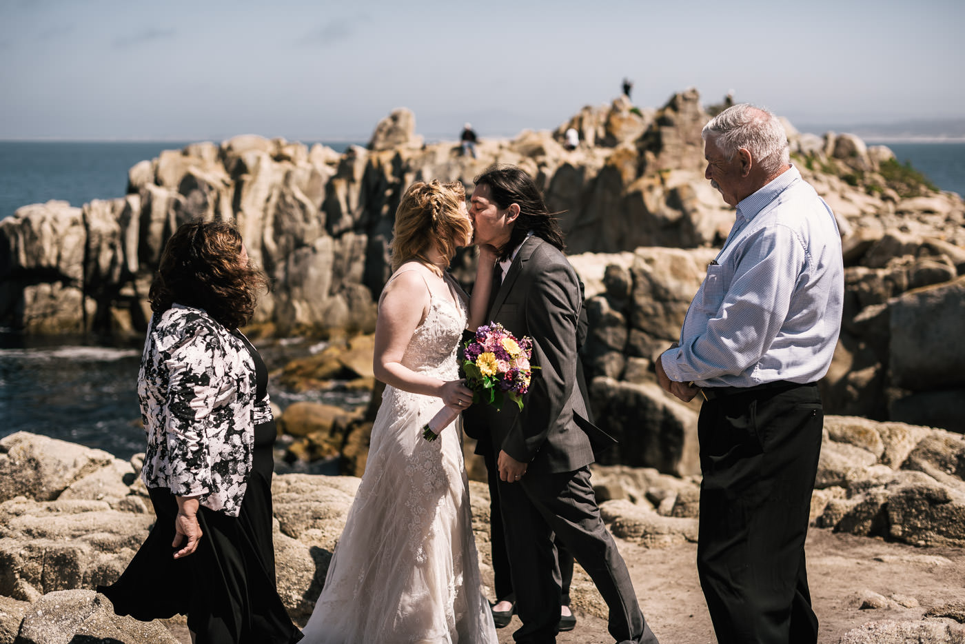 First kiss at a romantic wedding ceremony at Lovers point in Pacific grove.
