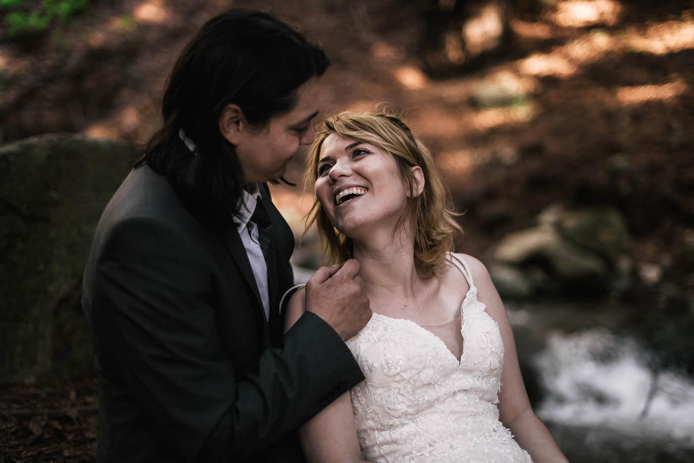 Bride gives her husband a big smile at their elopement.