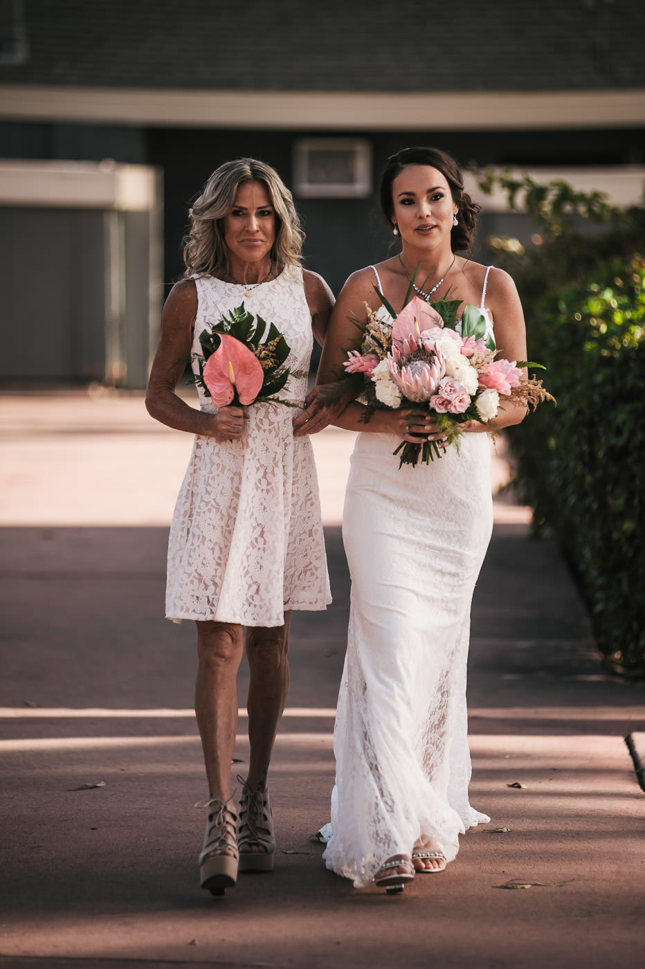Bride walks down the aisle with her mother at Marina Village.