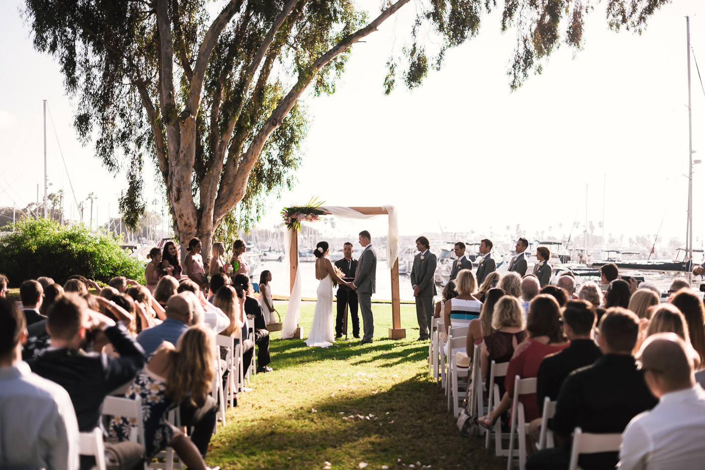 Wedding ceremony at sunset in Marina Village.