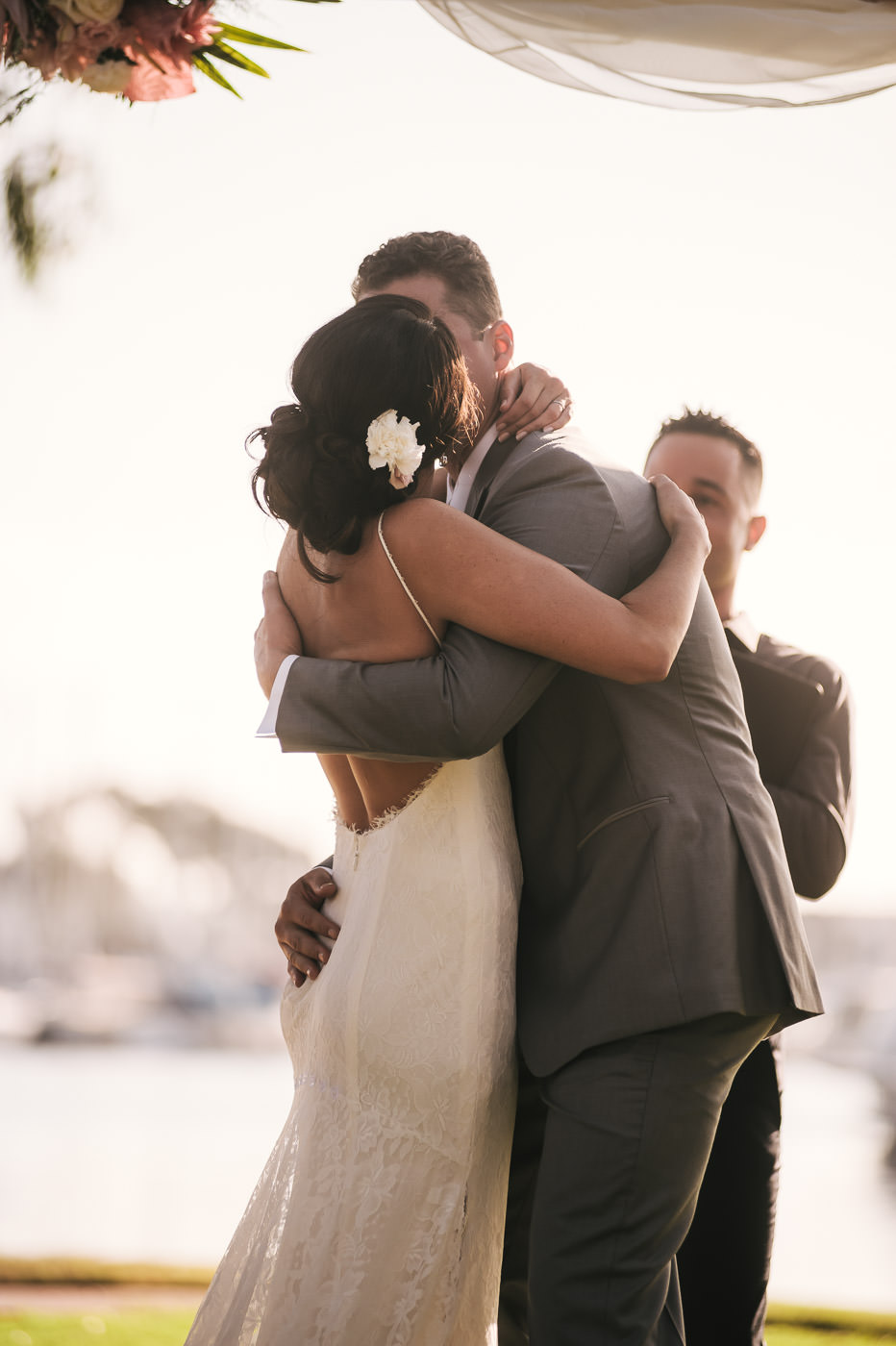 Passionate first kiss at this Marina Village wedding in San Diego California.