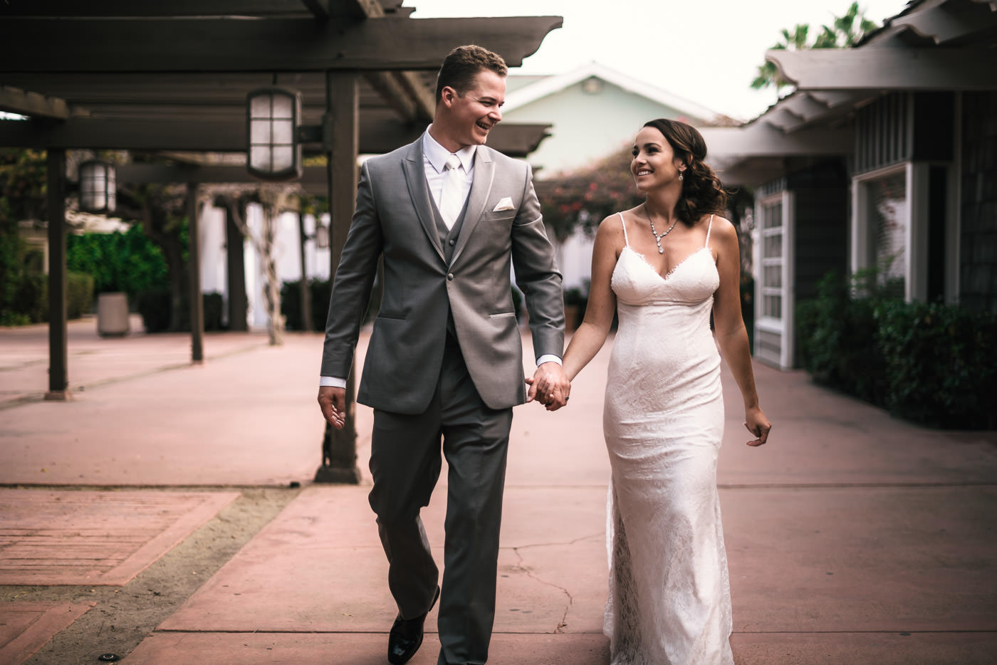A couple in love walks hand in hand through Marina VIllage.
