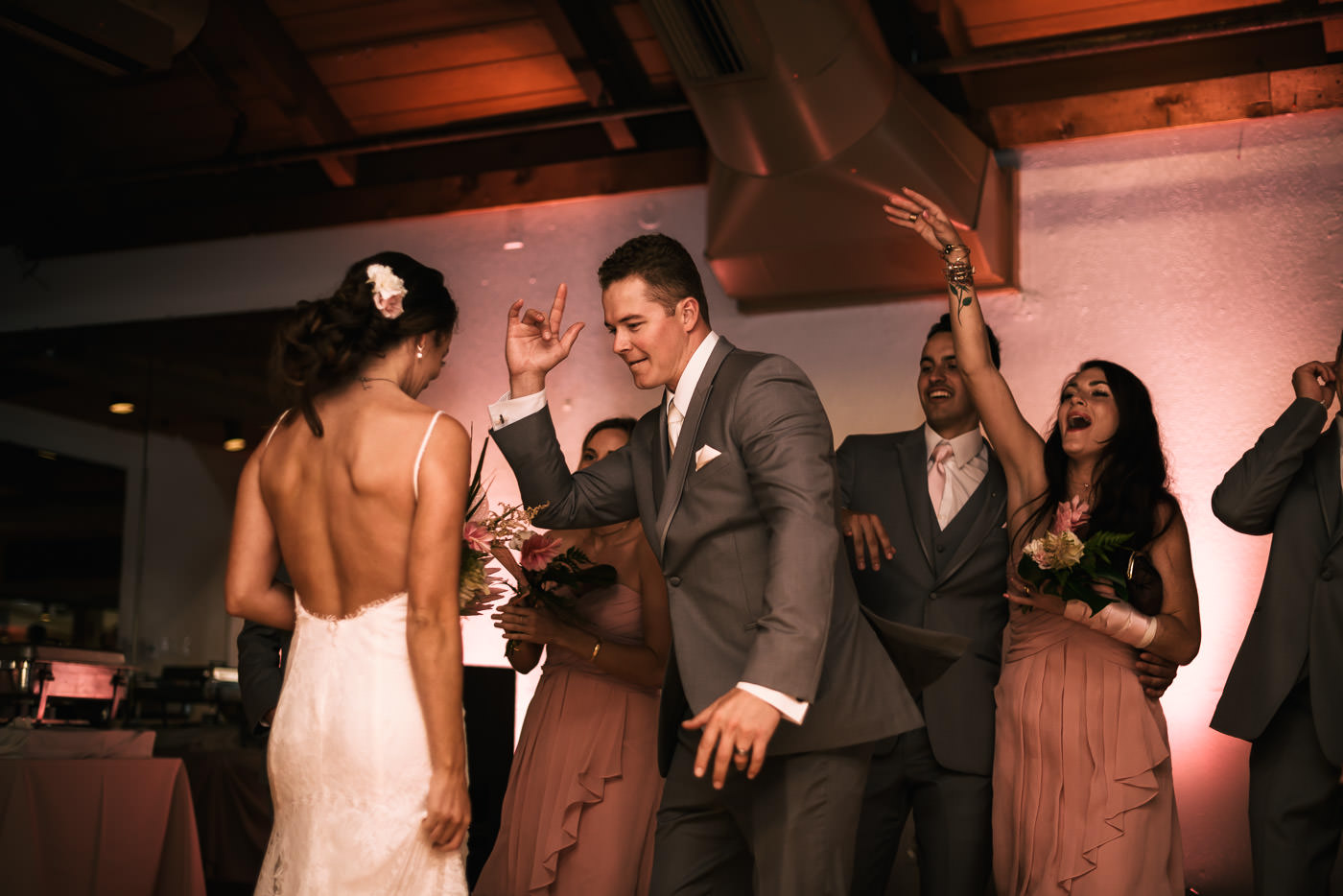 Couple hits the dance floor at their Marina VIllage reception.