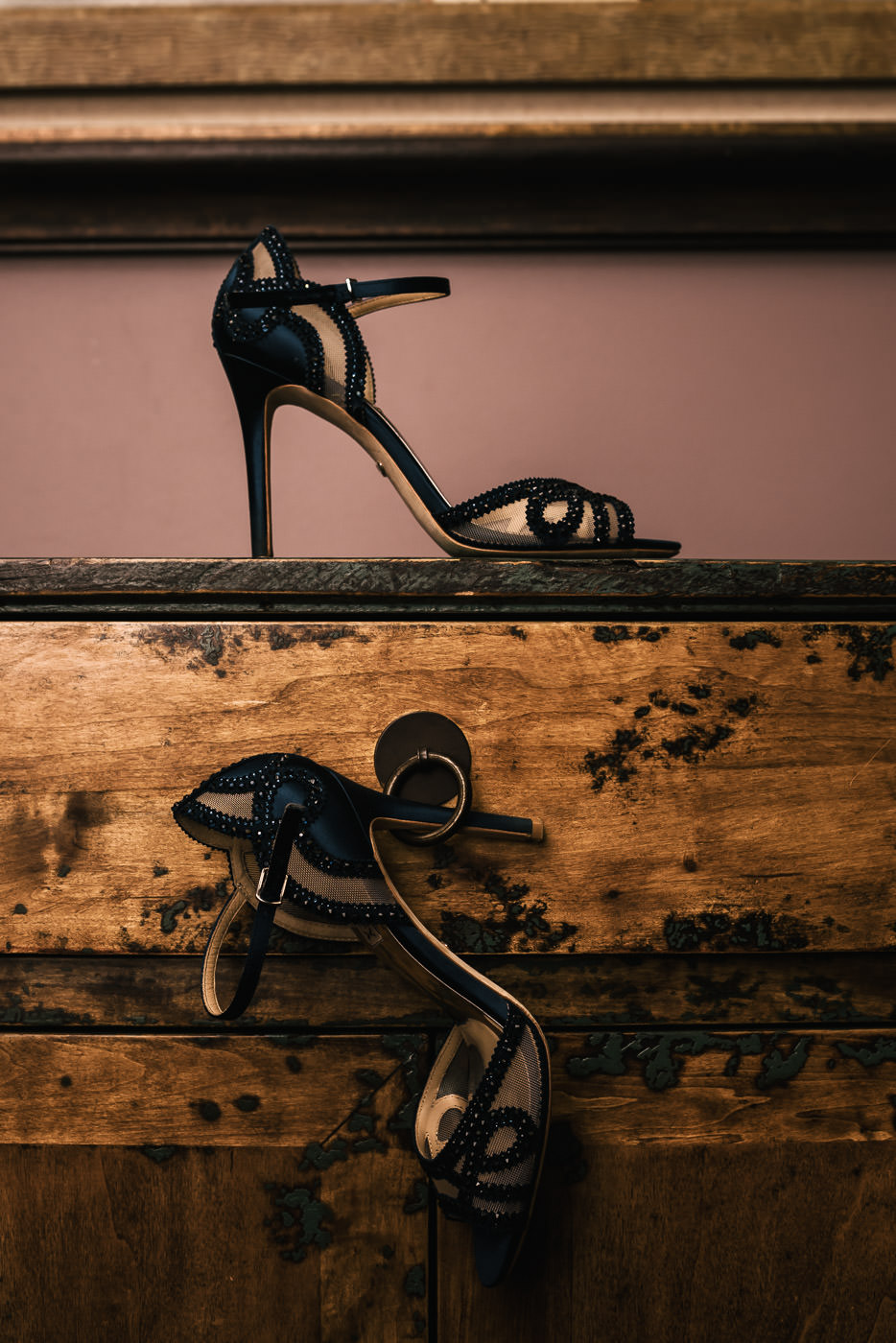 Brides dark blue heels with lace and sequine details.