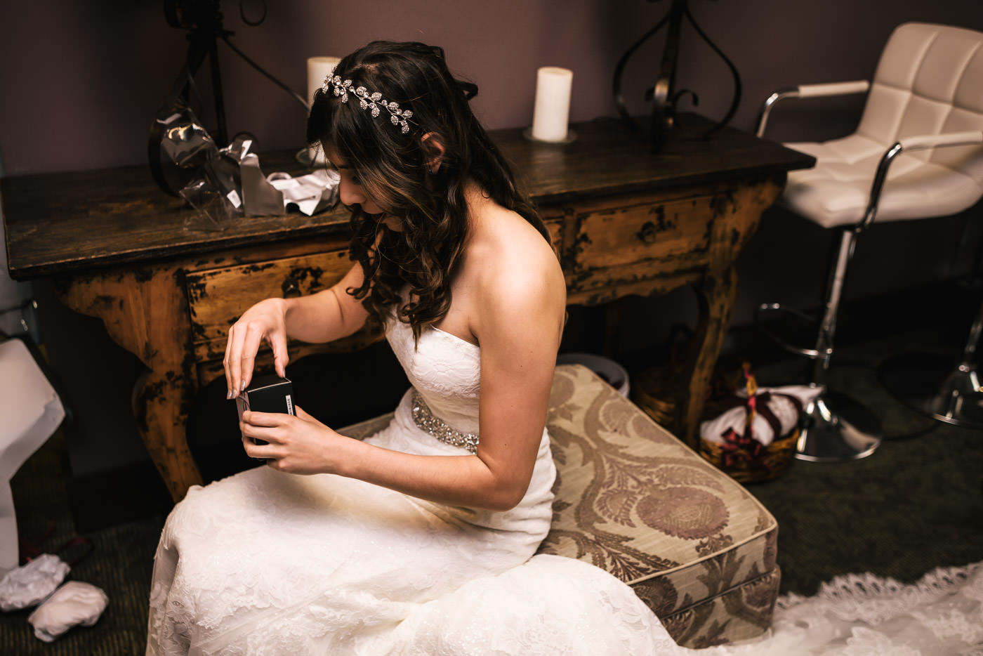 Bride opens a gift from her soon to be husband.