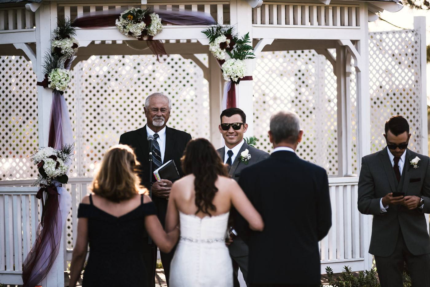 Happy groom is all smiles as he stares at his beautiful bride.