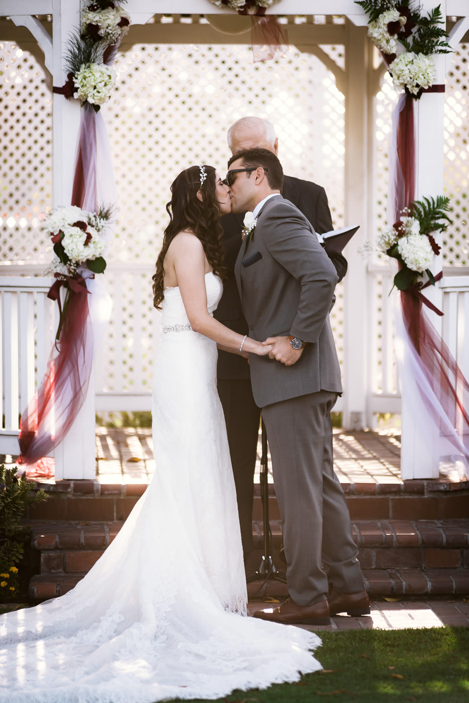 Newlyweds have their first kiss at this Alta Vista Country Club ceremony.