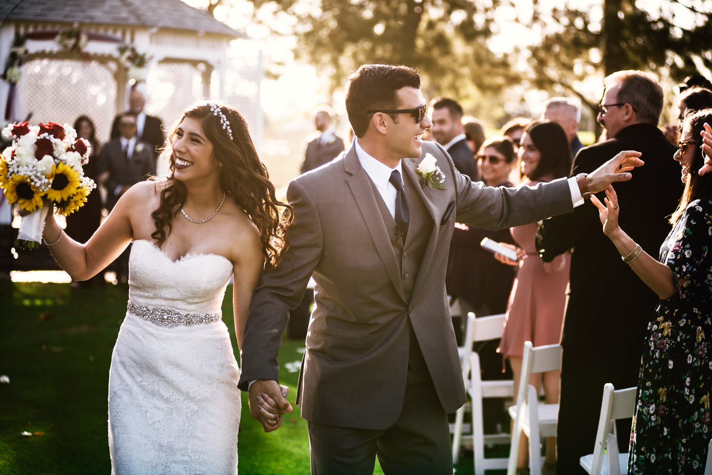 Newlyweds walk down the aisle as husband and wife.