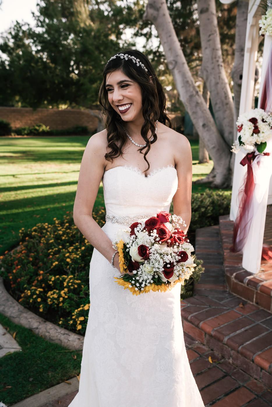 Beautiful bride poses at sunset in Placentia California.