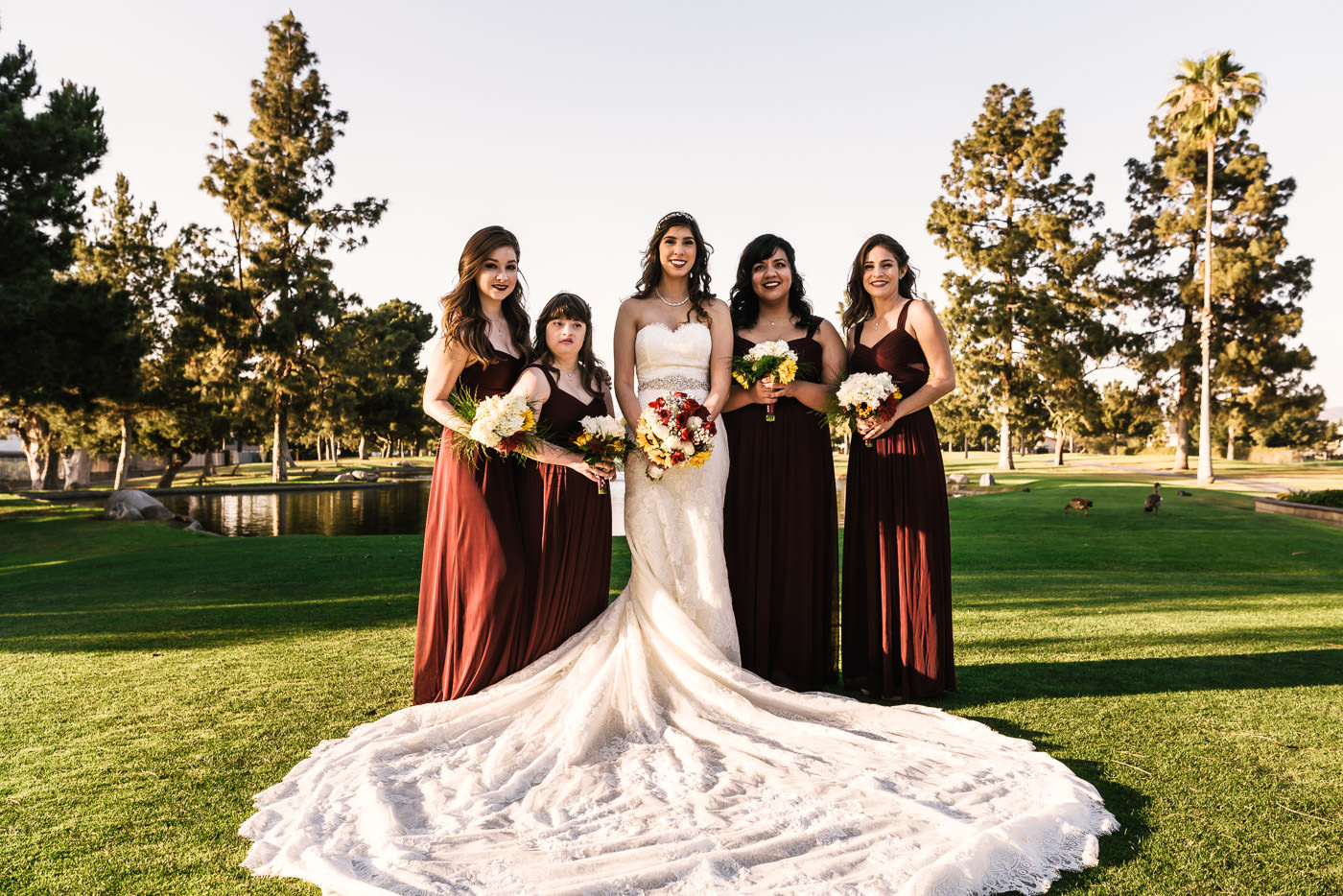Bride poses with her bridesmaids on the grounds of the Alta VIsta Country Club.