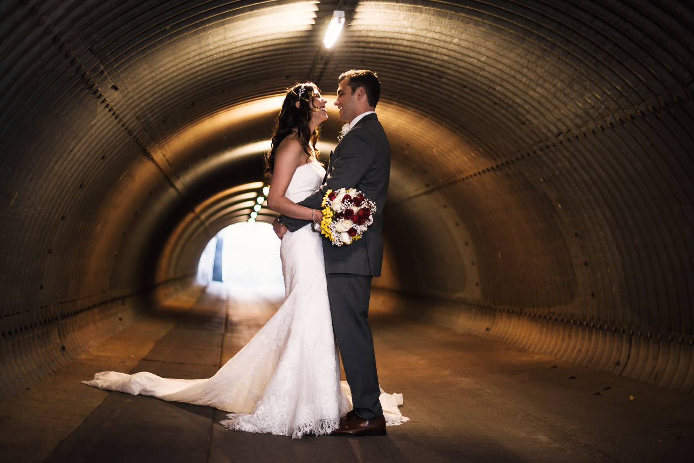 The tunnel at the Alta Vista Country Club makes the perfect backdrop for romantic wedding photos.