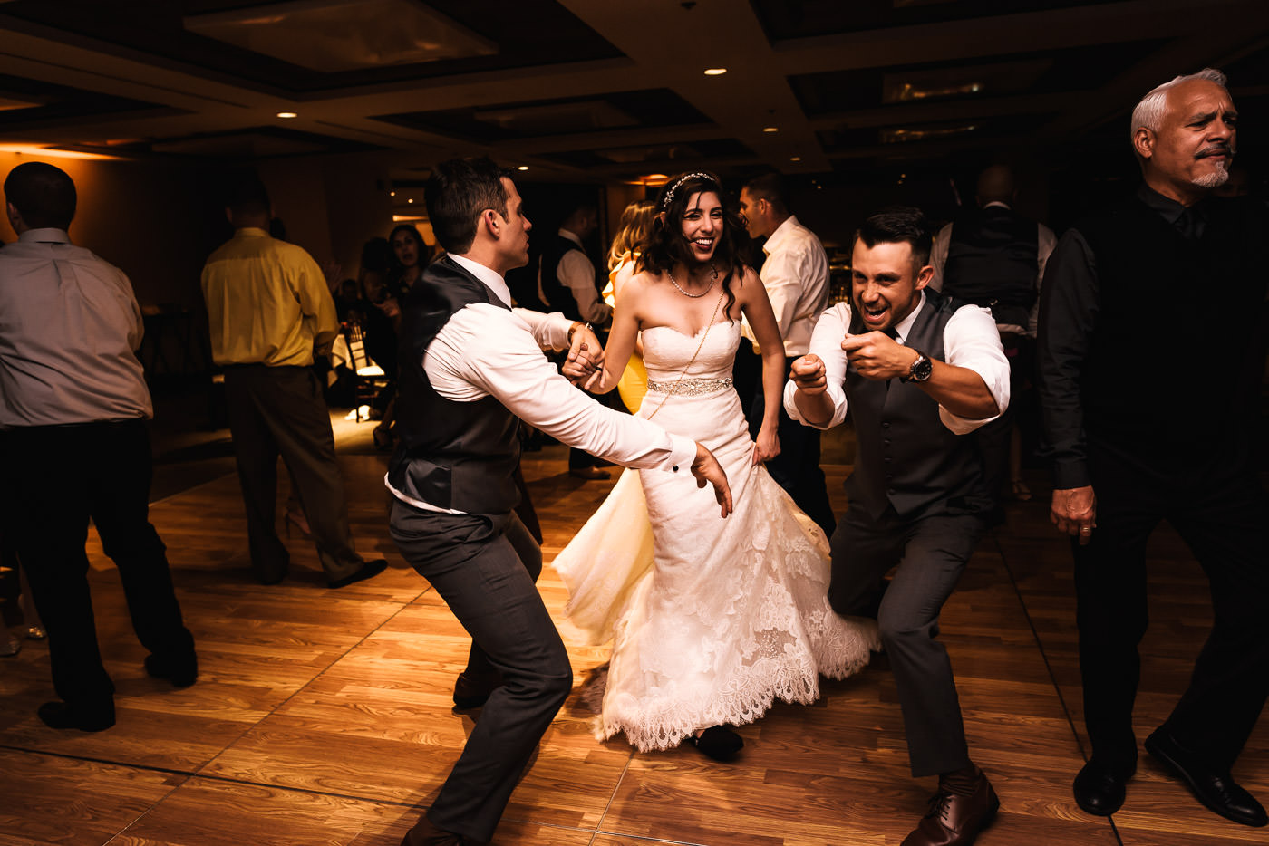Couple dances with their guests at the reception.