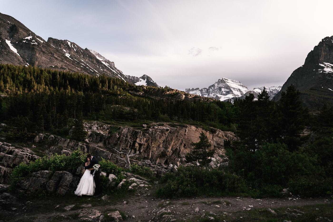 Glacier elopement Photography package - I simply can't get enough of photographing weddings in the stunning landscapes Glacier provides. Whether you're planning a wedding near the park, or an elopement out in the wilderness, you'll find an all day wedding photography package perfect for your love story below. Take me on your adventure, and we'll create something truly spectacular.