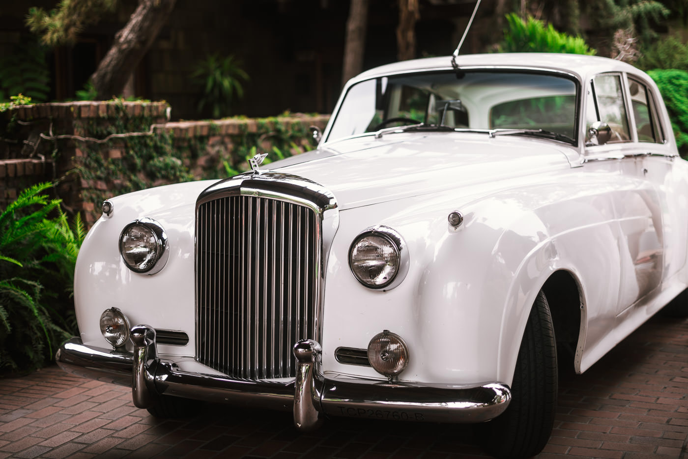 Classic Rolls Royce arrives to carry the bride to her wedding venue.