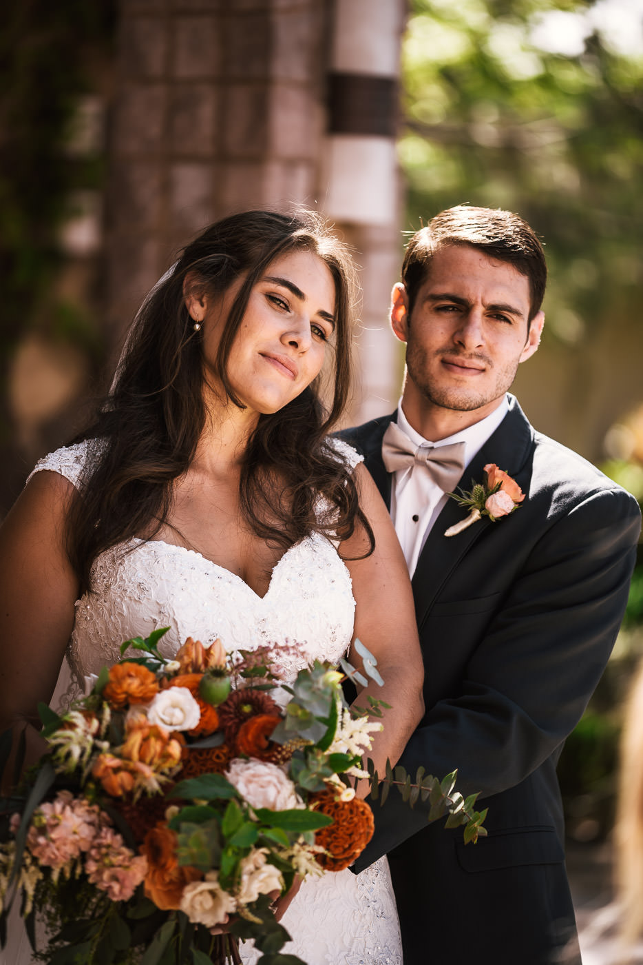 Stunning bride and groom pose to create beautiful wedding photos.