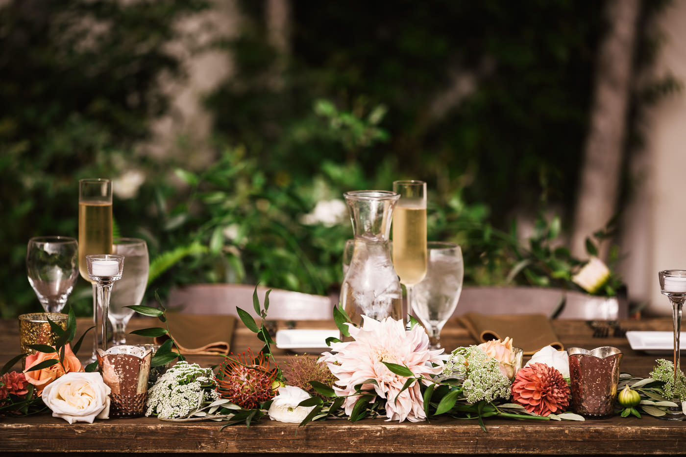 Sweetheart table decorations and floral arrangements.