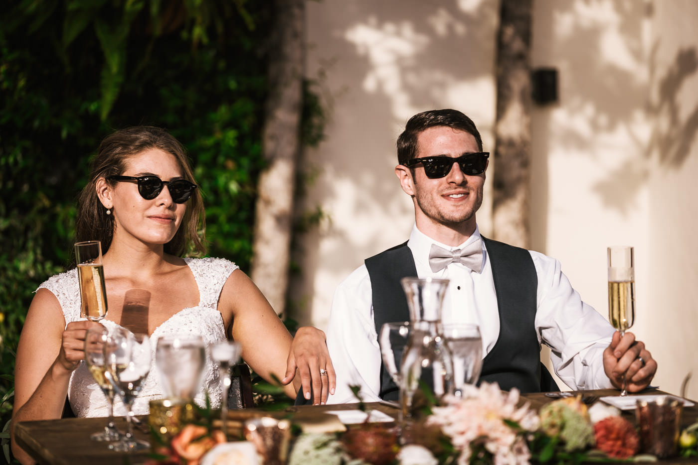 Couple rocks their shades for a cool picture at their reception.