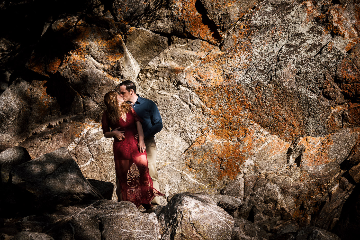 Tender kiss between these two lovebirds in the mountains of southern California.