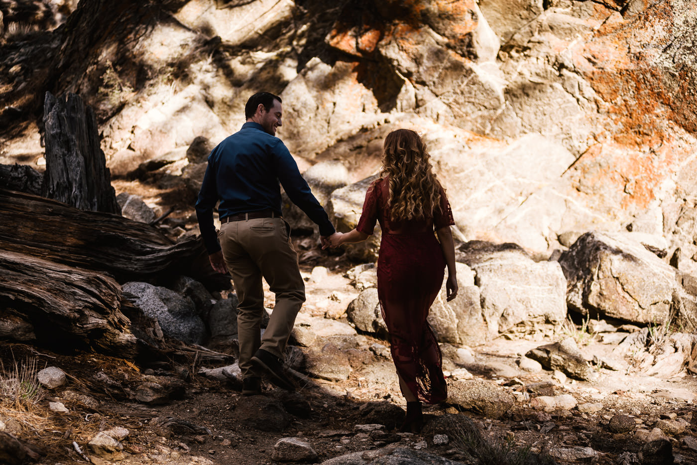 Groom to be leads his fiance through the forest.