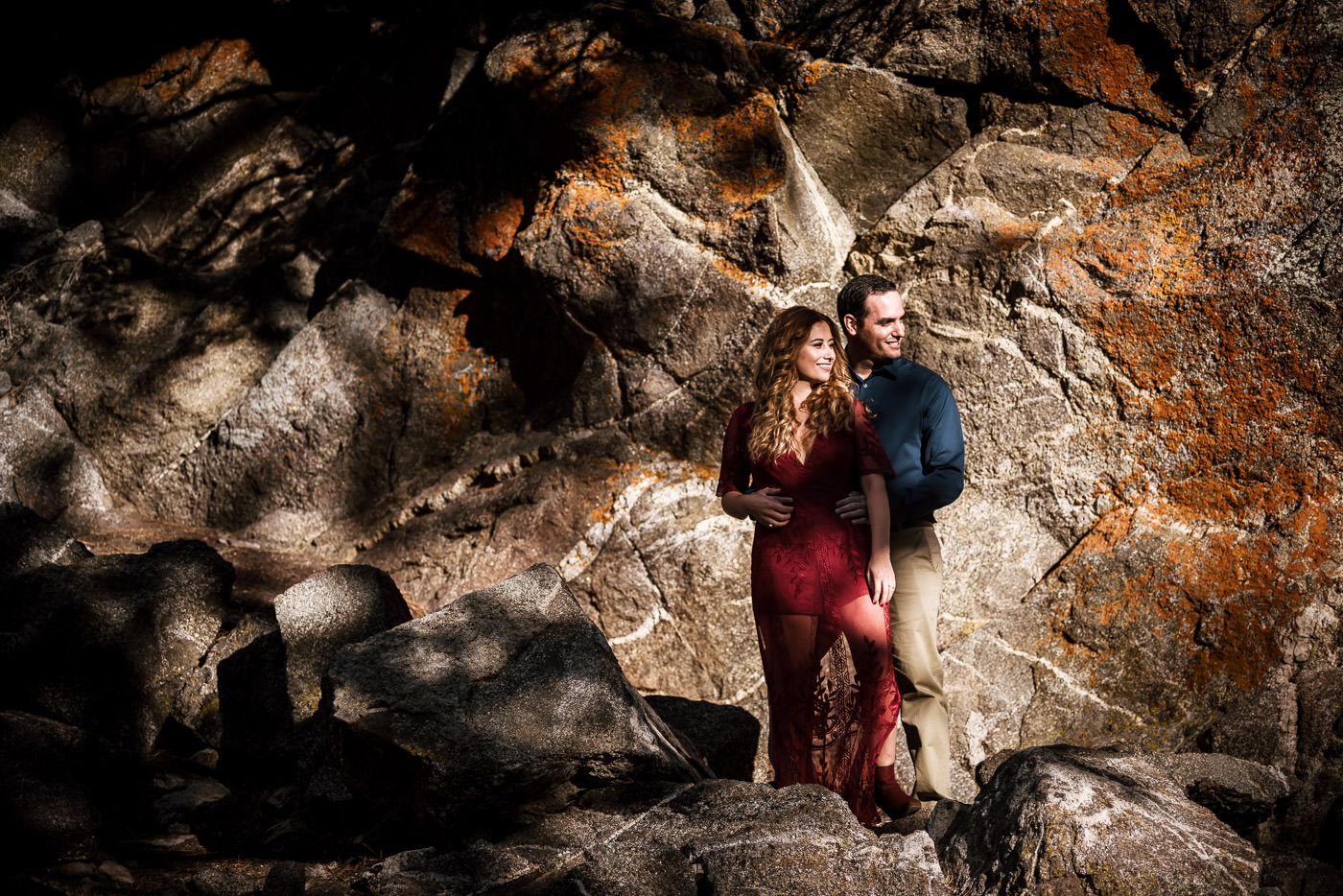 Stoic couple poses for stunning engagement photograph.
