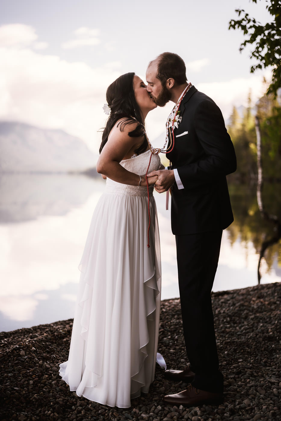 Couple has the first kiss at their adventurous elopement.