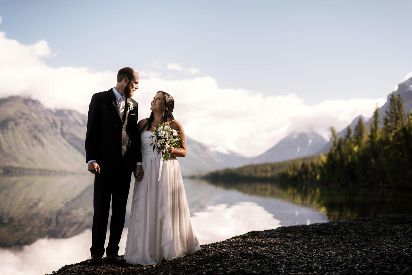 Loving newly married couple stands side by side for a romantic portrait in Montana.