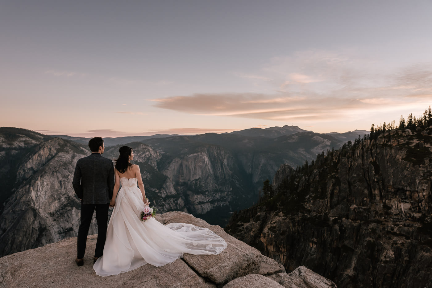 A sunrise elopement session at Taft Point - Sunrise sessions are always a little extra special. It takes a lot of willpower to get out of bed and hit the trail at 4am to make it out to your ceremony site. But it is so worth it. Ayana and Hiroshi chose Taft Point on Yosemite's southern rim for a romantic elopement session as the sun rose on the valley below. Taft Point has always been a favorite spot of mine, so it was nothing short of a dream come true photographing a couple so in love there. But the day was still young and we were feeling adventurous.