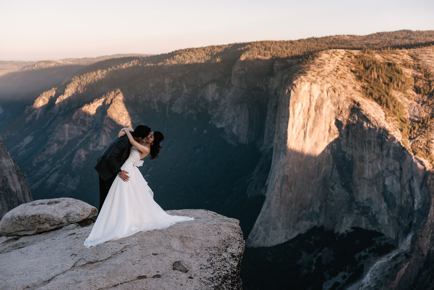 Groom dips his bride for a romantic portrait they'll never forget.